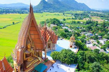 Big golden Buddha statue at Wat Tham Suea Kanchanaburi, Thailand.