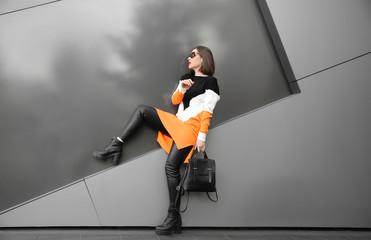 Beautiful fashionable woman near grey wall outdoors Wall mural