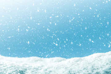 Winter background with snow and glitter in blue gradient color. Merry Christmas and Happy new year backdrop.