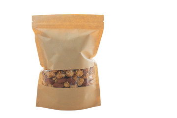 Popcorn caramel in brown kraft zip lock bag on white background.