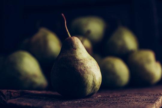 Juicy pears on dark background