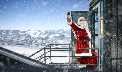 Red old Santa Claus and winter landscape