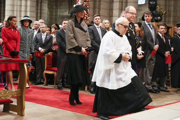 Princess Stephanie of Monaco, Princess Caroline of Hanover, Princess Charlene of Monaco, Father Penzo and Prince Albert II of Monaco arrive at the cathedral to attend a mass as part of the celebrations marking Monaco's National Day in Monaco