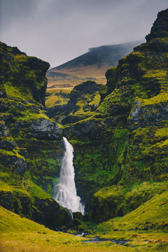 Majestic waterfall Seljalandsfoss in Iceland in autumn in cloudy weather