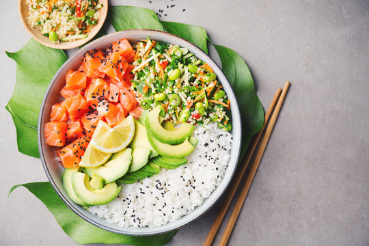 Poke bowl with salmon served in bowl