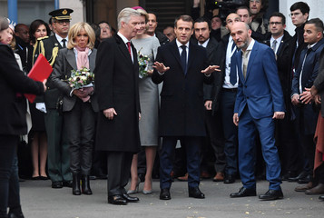 French President Emmanuel Macron and his wife Brigitte Macron, accompanied by Belgian King Philippe and Queen Mathilde visit the LaVallee Creative Work Center in the Molenbeek district of Brussels