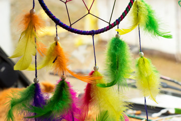 Colorfull dream catcher in a car on the windshield