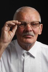 Emotional grandfather in glasses