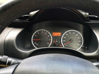 Car dashboard panel with fuel, rpm and speedometer gauge