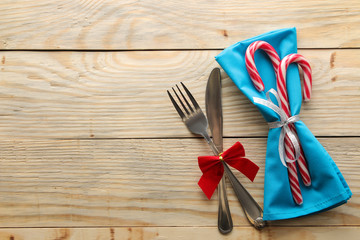 Christmas table setting. Knife and fork . on a natural wooden table. top view With space for an inscription. new Year. holidays