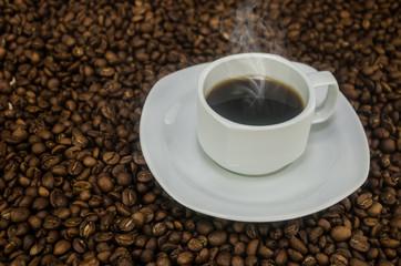 Coffee mug over grain texture
