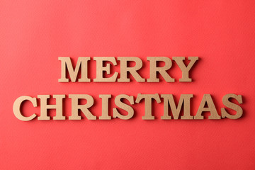 inscription Merry Christmas. gold letters on a red background. holidays. Christmas.