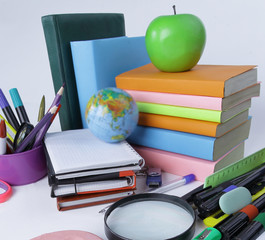 two candy and school supplies on a white background