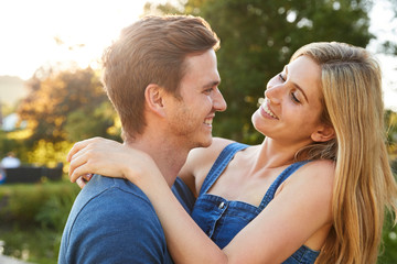 Loving Couple Hugging Outdoors In Summer Park