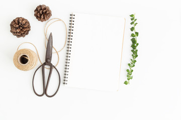Blank notebook and scissors on white background, Top view image of white notebook and empty space for text