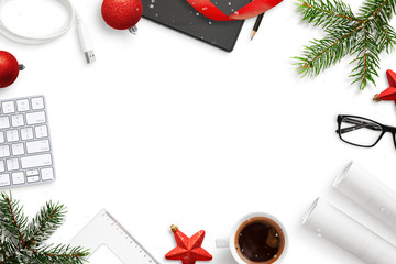 Office, work desk during Christmas and New Year composition. Supplies and decorations with copy space in the middle.
