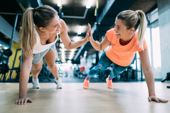 Beautiful young women working out in gym