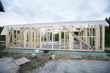 Frame of wooden house under construction