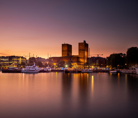 Oslo City Hall and harbour after sunset.