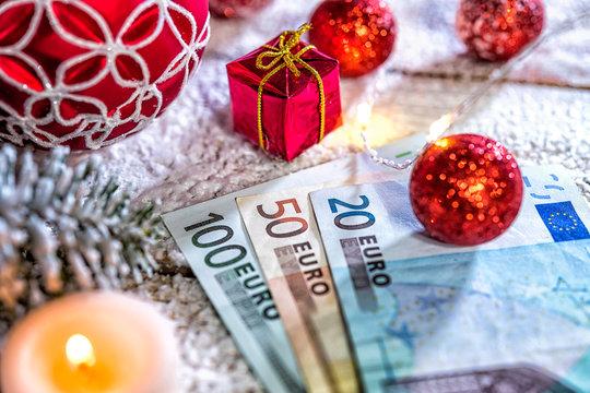christmas ball with euro banknotes