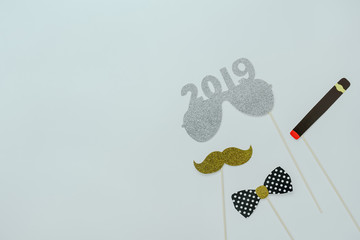 Table top view of Merry Christmas decorations & Happy new year 2019 ornaments concept.Flat lay essential difference objects to party season the photo booth prob on modern wooden white background.