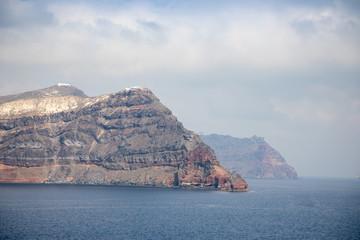 View of Thirasia from sea next to Santorini, Greece