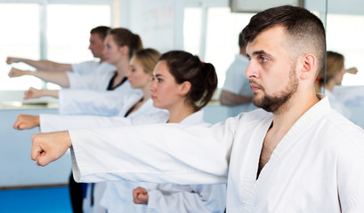 Wall Murals Martial arts Adults trying new martial moves at karate class