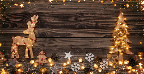 Christmas background with wooden decorations and candles.