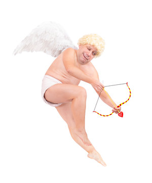 Funny flying angel shoot arrow of love, isolated on white background. Fat adult angel aiming arrow.