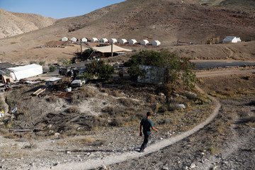 David Davidson, owner of Khan Eretz Ha'Mirdafim resort, walks through the camp, near Alon settlement, in the occupied West Bank