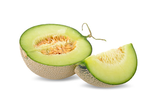 half and portion cut ripe sweet honeydew green melon on white background