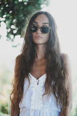 Portrait of beautiful woman with long hair outdoors