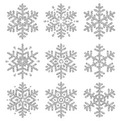 Set of silver glittering snowflakes  over white backgrounds, vector illustration