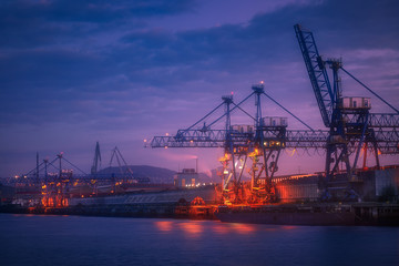 industrial background with cranes in Sestao port