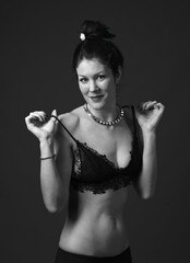black and white photograph of young woman with lace bra