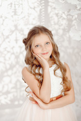 Portrait of beautiful child girl in white dress, concept christmas.