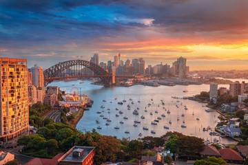Fototapete - Sydney. Cityscape image of Sydney, Australia with Harbour Bridge and Sydney skyline during sunset.