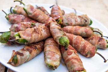 Dish with Grilled Peppers stuffed and covered with bacon
