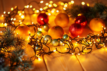 Christmas decorations with lights on a wooden surface