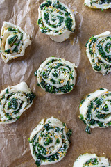 Uncooked spinach pinwheel puff pastry dough flat lay