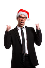 Photo of cheerful guy in business suit, glasses, santa hat