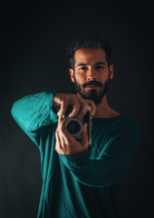 studio session with model and retro vintage camera