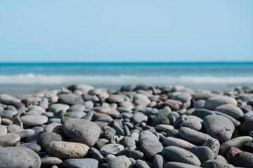 pebble stone beach - stones at ocean coast -