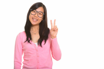 Young happy Asian woman giving peace sign