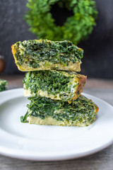 spinach souffle cut pieces stacked