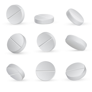 Round white medical pills in different positions