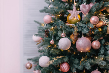 decorated christmas tree near white wall