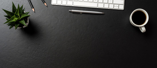 Business accessories on dark background with copy space