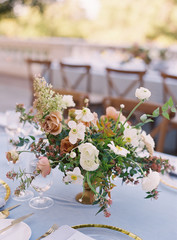 Flowers as a centerpiece on a table for a wedding reception