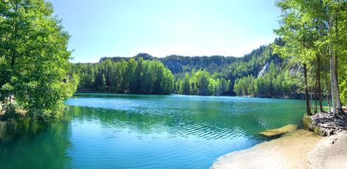 Adršpach-Teplice Rocks in Czech Republic. Piskovna Lake. Blue lake in the mountains. High resolution picture.